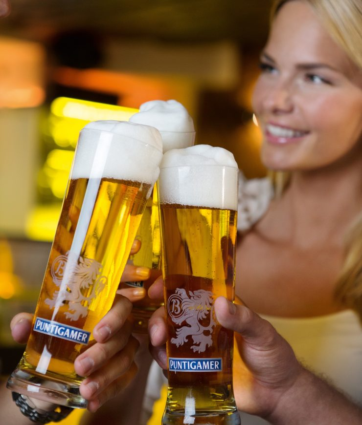 Three glasses of beer and young woman